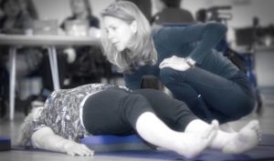 Physiotherapist & Yoga Teacher TillyLou uses a Standard Buttafly works with a lady suffering from back pain